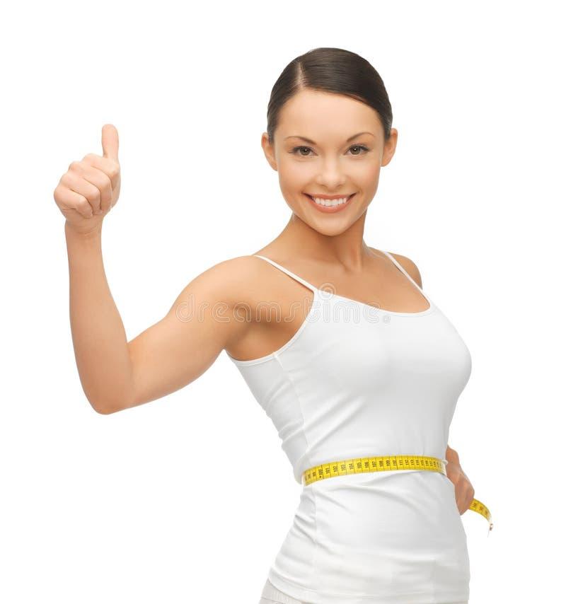 Kobieta z pomiarową taśmą zdjęcie royalty free