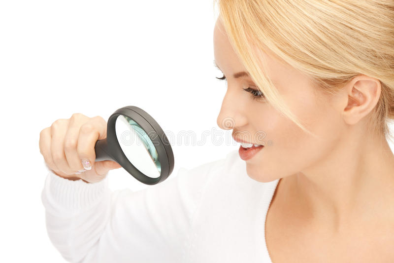 Kobieta z powiększać - szkło zdjęcie stock