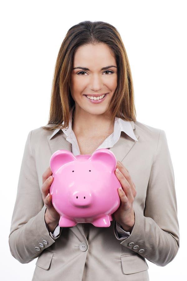 Kobieta z prosiątko bankiem zdjęcie stock