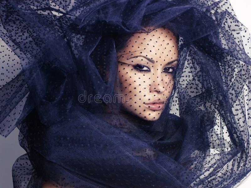 Kobieta z przesłoną zdjęcia stock