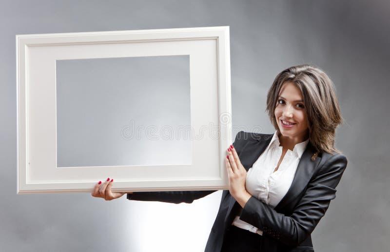Kobieta z ramą obrazy royalty free