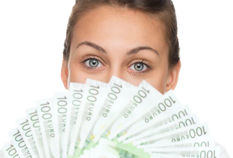 Kobieta z stosem pieniądze zdjęcia royalty free