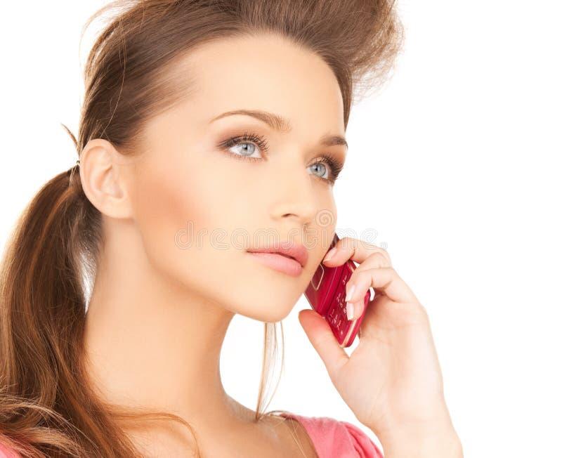 Kobieta z telefonem komórkowym obraz stock