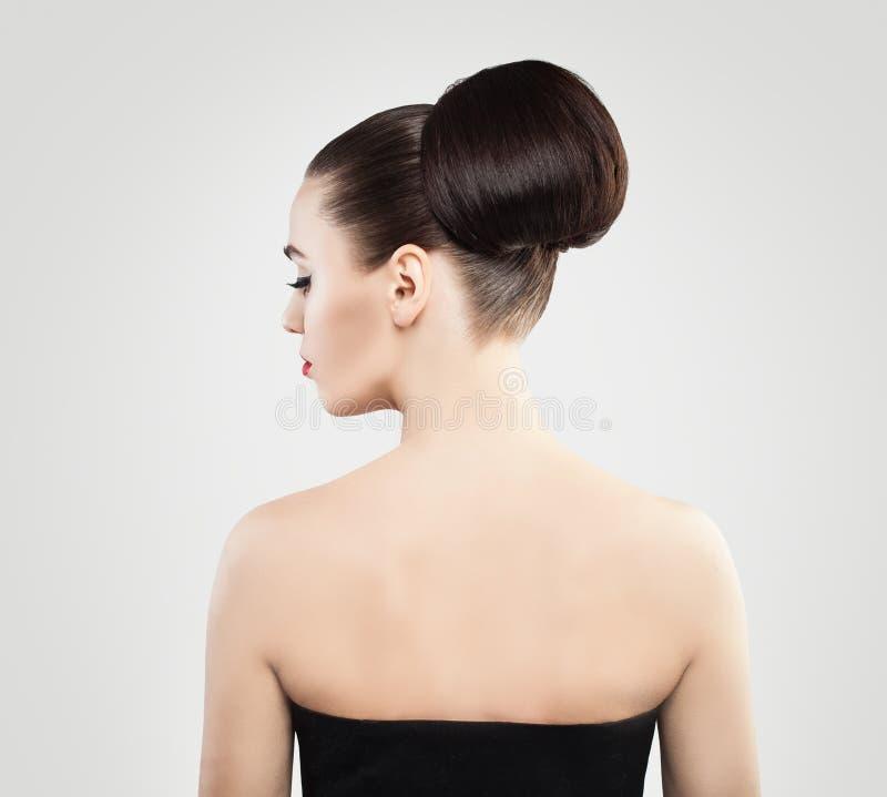 Kobieta z Updo włosy Kobiety spojrzenie i zdjęcia stock