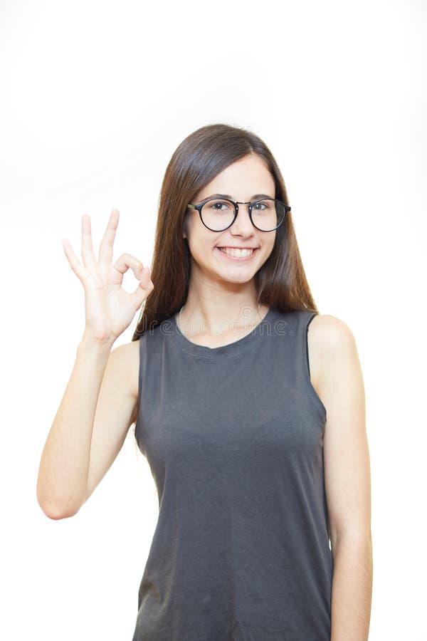 Kobieta z zadowalającym gestem odizolowywającym nad białym tłem zdjęcia stock
