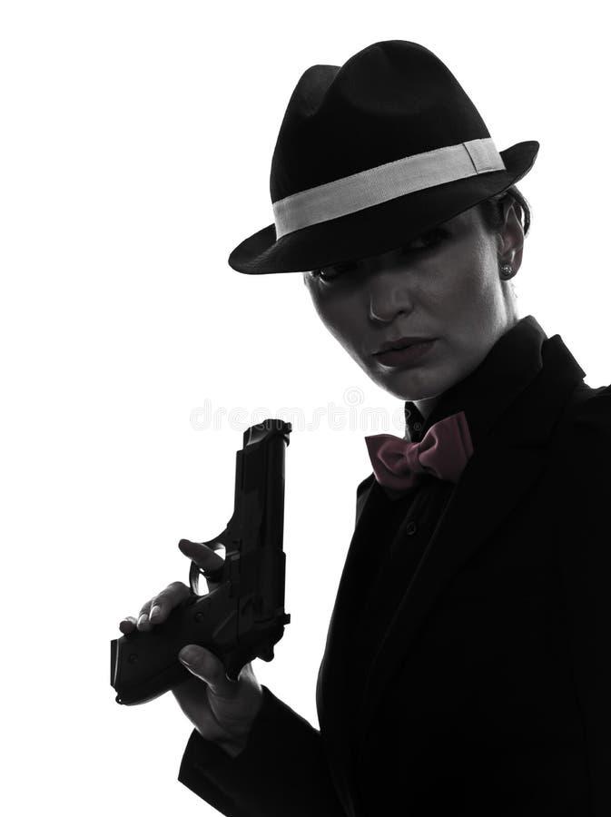Kobieta zabójcy armatnia gangsterska sylwetka obraz stock