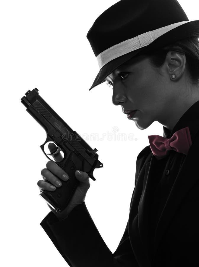 Kobieta zabójcy armatnia gangsterska sylwetka zdjęcie stock