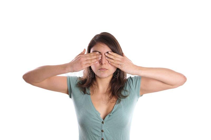 Kobieta zakrywa ona oczy zdjęcie stock
