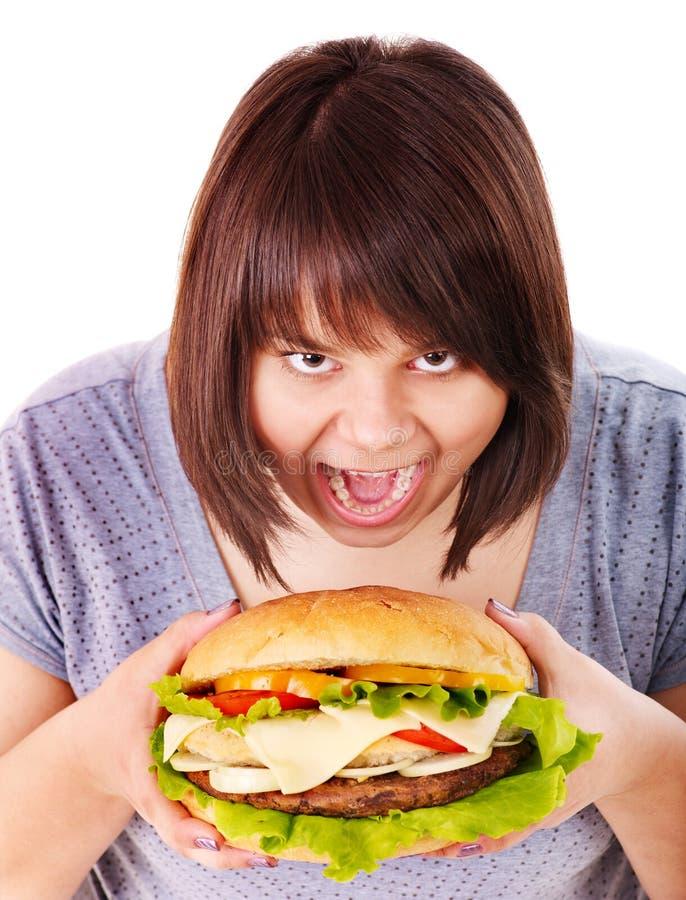 Kobiety łasowania hamburger. zdjęcie stock