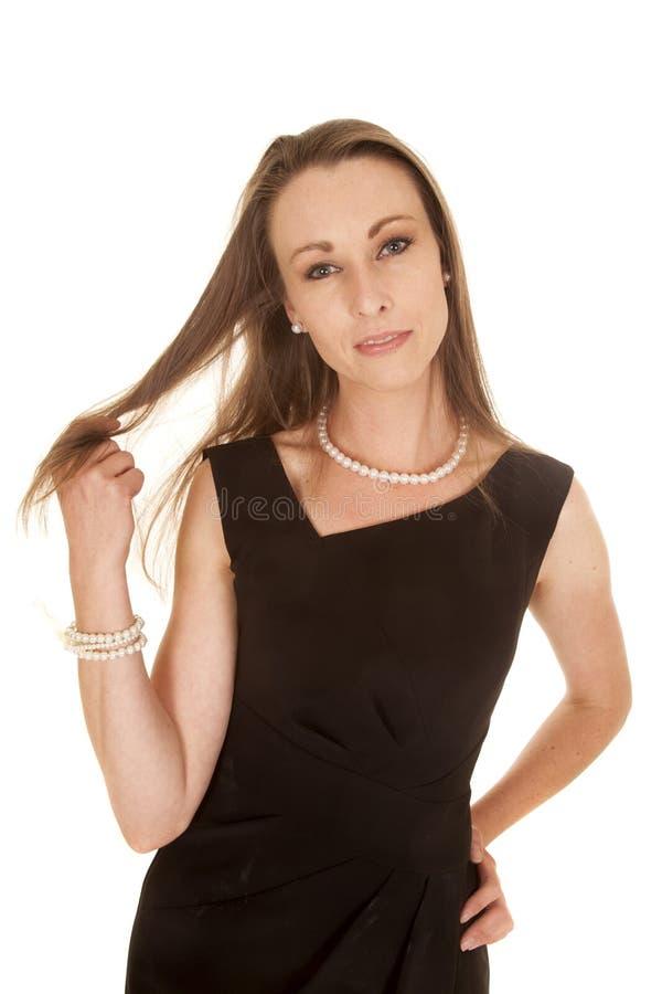 Kobiety czerni sukni poważna sztuka z włosy fotografia royalty free
