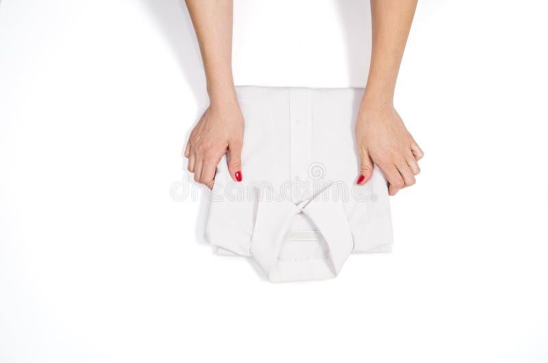 Kobiety falcowanie odziewa Odgórny widok na białym tle z copyspace obraz royalty free