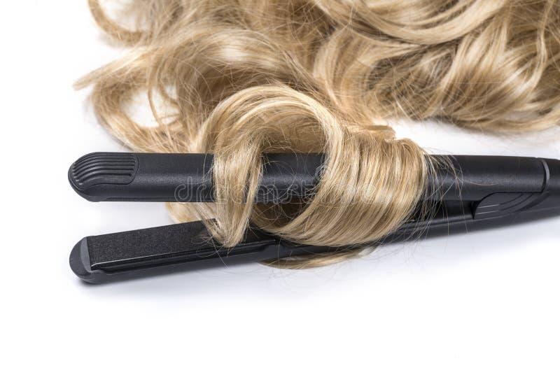 Kobiety fryzury długi z włosami robi żelazo obraz royalty free