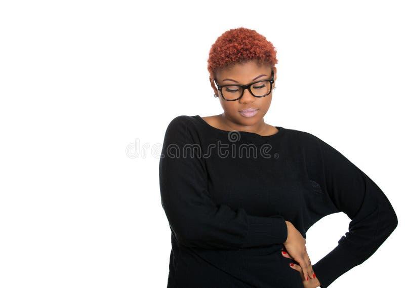 Kobiety główkowanie, rojenie coś, patrzeje w dół, beznadziejny obraz stock