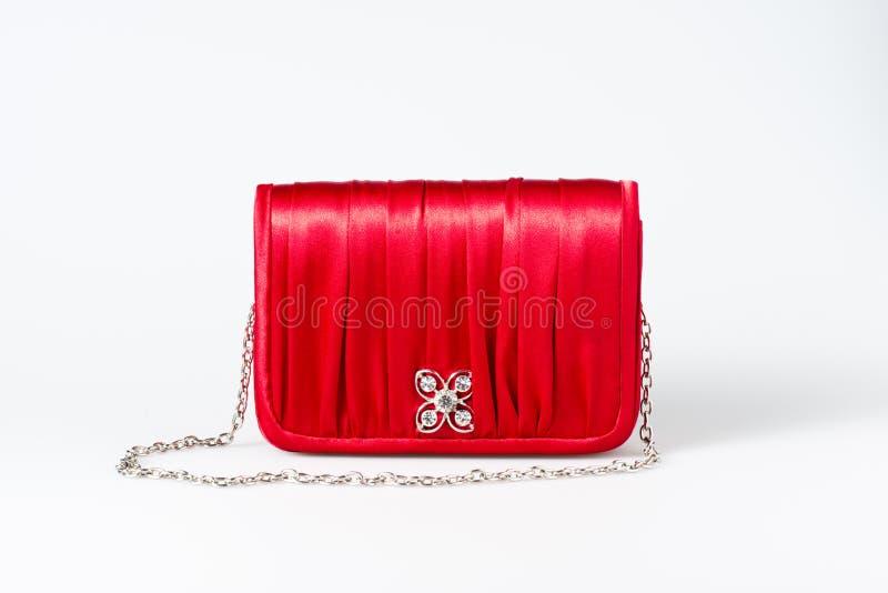 Kobiety mała czerwona kiesa na bielu zdjęcie stock