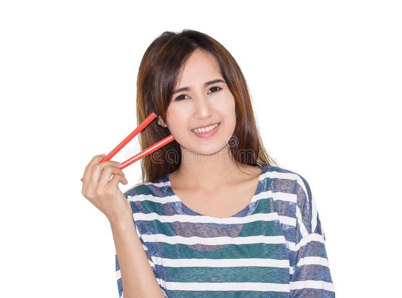 Download Kobiety mienia chopsticks zdjęcie stock. Obraz złożonej z odosobniony - 53787846