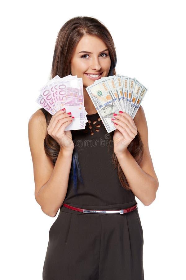 Kobiety mienia dolar amerykański i euro gotówkowy pieniądze zdjęcia royalty free