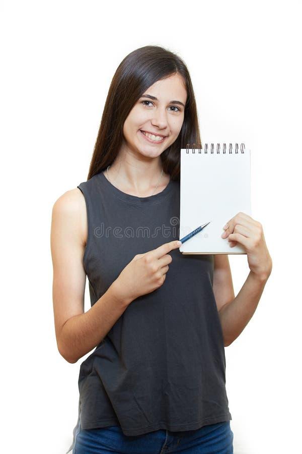 Kobiety mienia ołówek z notatnikiem i przyglądający up odizolowywający na a zdjęcia royalty free