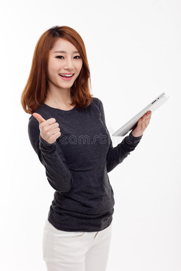 Kobiety mienia pastylki komputer odizolowywający na białym tle. zdjęcia royalty free
