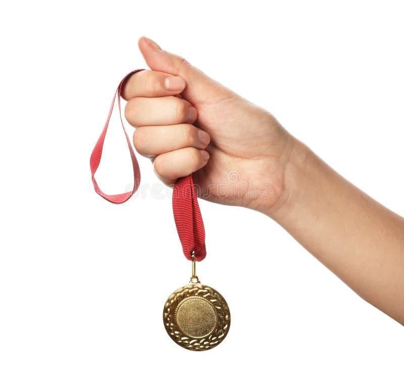 Kobiety mienia złoty medal z przestrzenią dla projekta na białym tle, zbliżenie zdjęcie royalty free