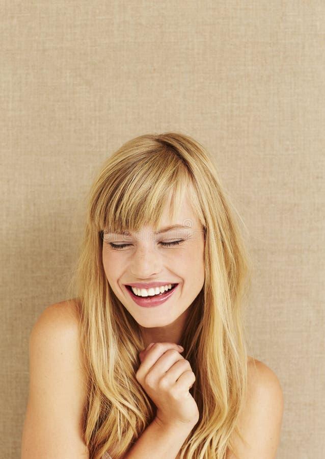 Kobiety ono uśmiecha się zdjęcia stock
