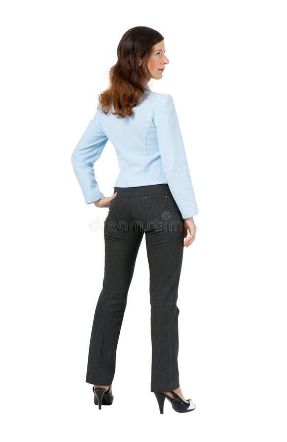 Kobiety pozycja z jego plecy na białym tle obraz stock