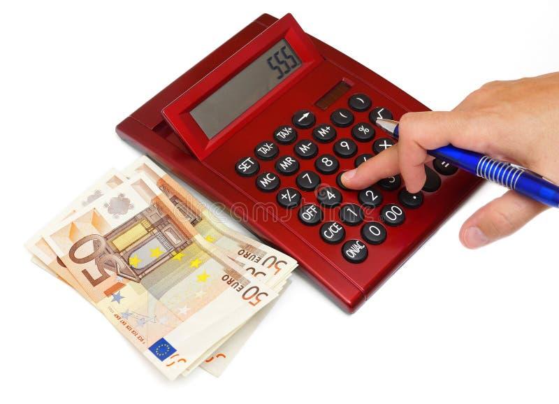 Kobiety ręka na kalkulatorze z pieniądze obraz stock