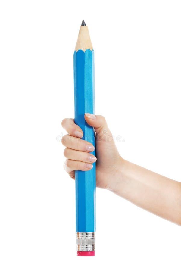 Kobiety ręka trzyma dużego ołówek. zdjęcia stock