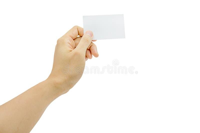 Kobiety ręka trzyma pustego papieru wizytówkę odizolowywająca na białym tle zdjęcia stock
