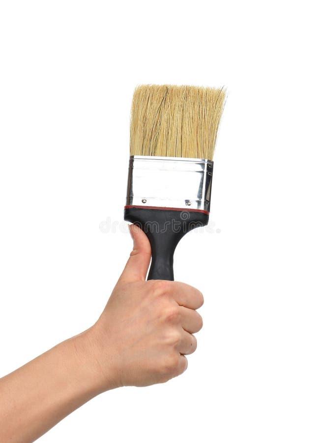 Download Kobiety Ręka Z Farby Muśnięciem Z Plastikową Drewnianą Rękojeścią Zdjęcie Stock - Obraz złożonej z mienie, arte: 53793392