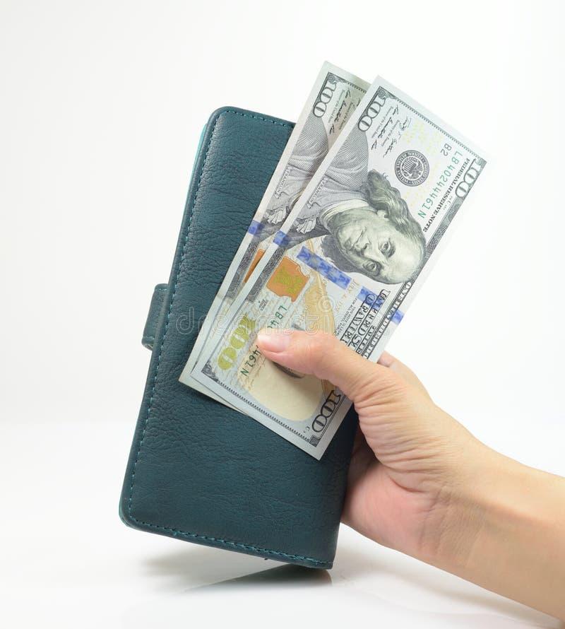 Kobiety ręka z portflem & pieniądze obraz royalty free