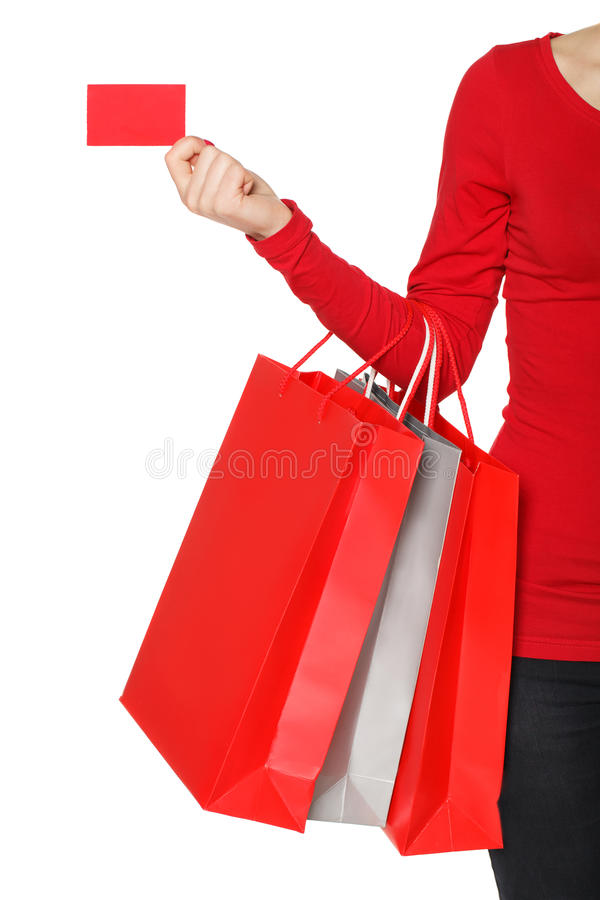 Kobiety ręka z wiele kredytową kartą i torba na zakupy obraz royalty free