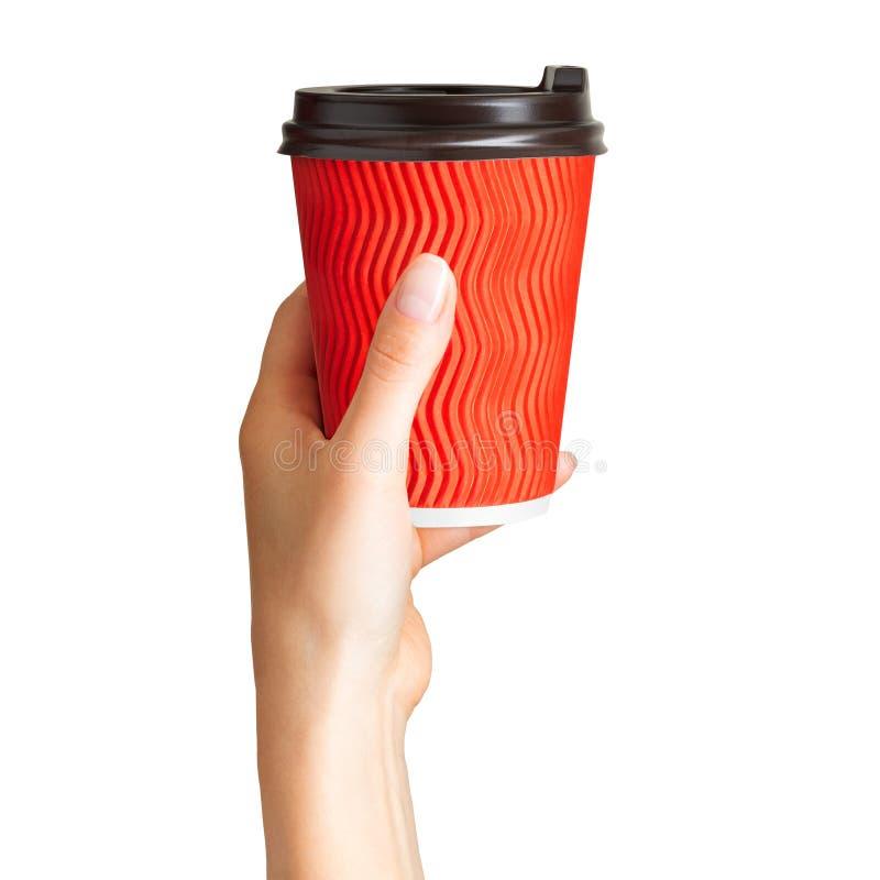 Kobiety ręki mienia kawy papierowa pije filiżanka zdjęcie royalty free
