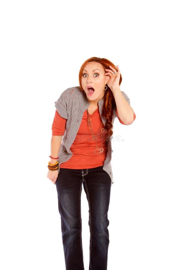 Kobiety słuchanie z szokiem i niewiarą zdjęcia stock