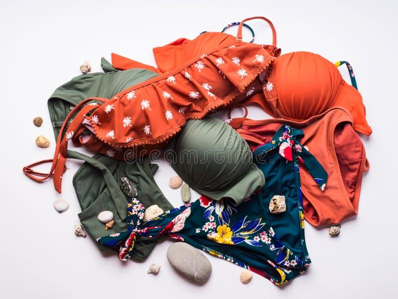Kobiety ` s swimsuits na bielu zdjęcie royalty free