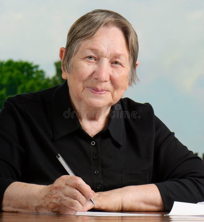 kobiety starszy writing obraz royalty free
