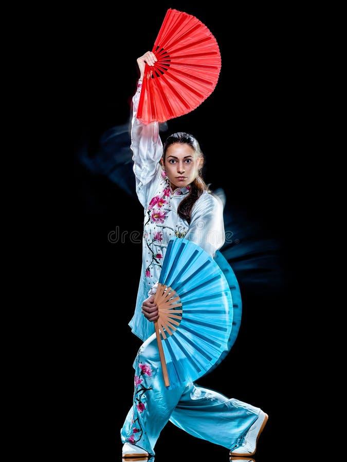 Kobiety Tai Chi Chuan Tadjiquan postury czerni t?a ?wiat?a obraz obraz royalty free