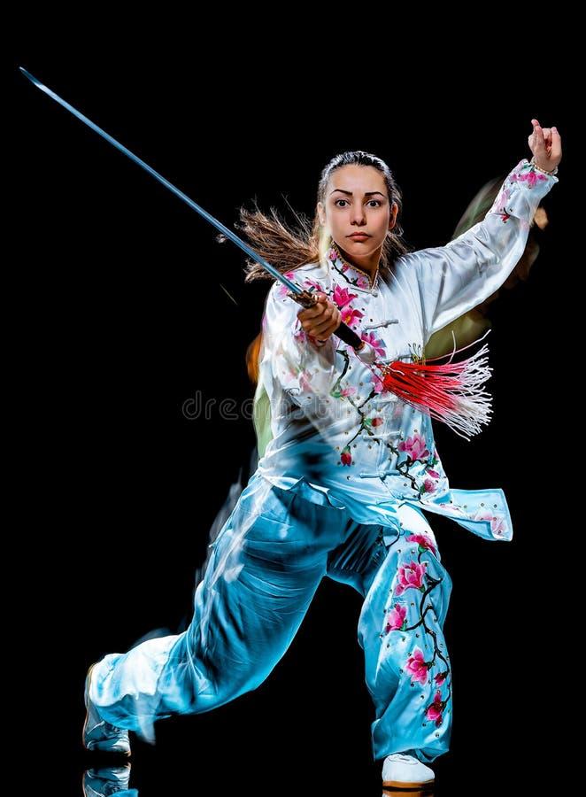 Kobiety Tai Chi Chuan Tadjiquan postury czerni t?a ?wiat?a obraz zdjęcie stock