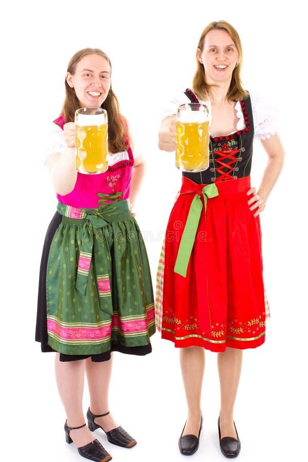 Kobiety w dirndl ma zabawę przy Oktoberfest fotografia stock