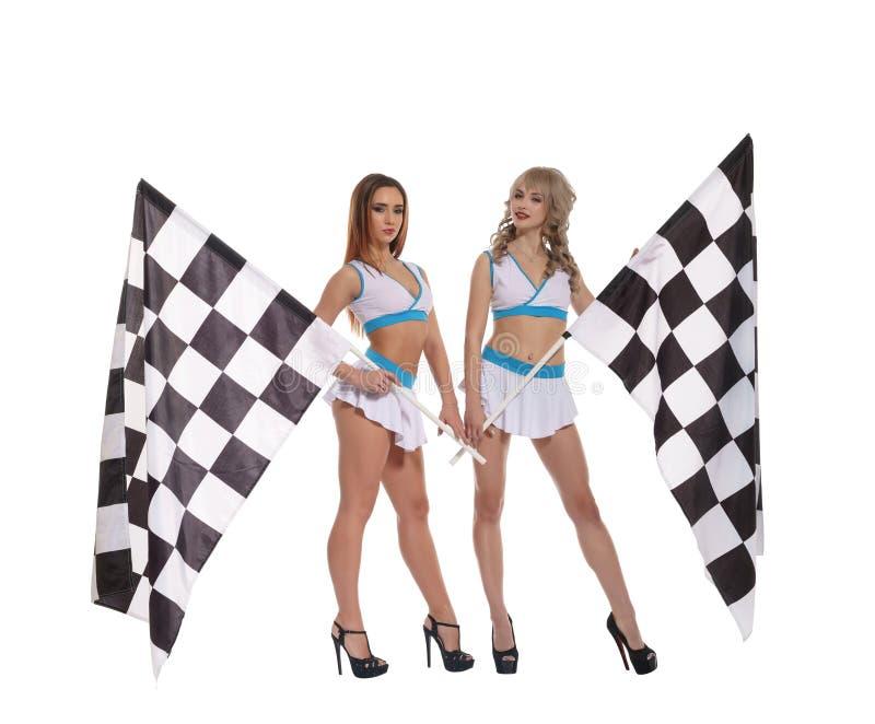 Kobiety w mundurze z w kratkę biegowymi flaga fotografia stock