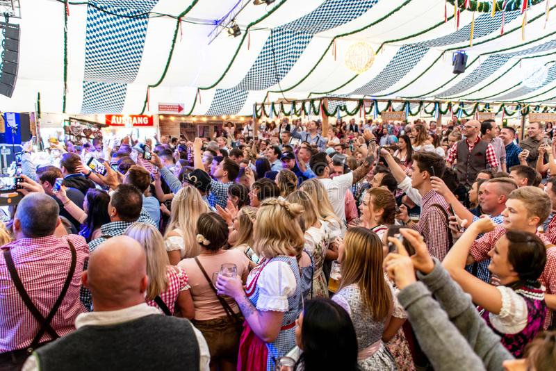 Koblenz Germany -26.09.2018 people party at Oktoberfest in europe during a concert Typical beer tent scene.  stock photography