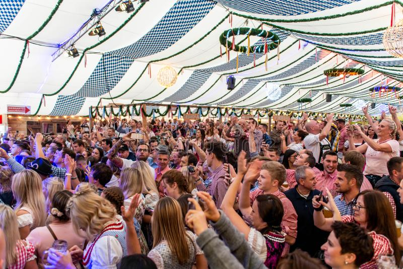 Koblenz Germany -26.09.2018 people party at Oktoberfest in europe during a concert Typical beer tent scene.  stock photos