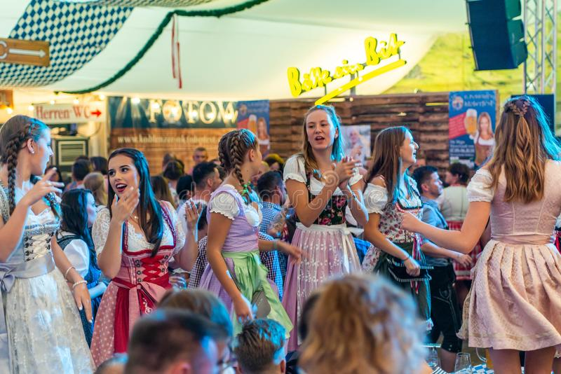 Koblenz Germany -26.09.2018 people party at Oktoberfest in europe during a concert Typical beer tent scene.  royalty free stock photos