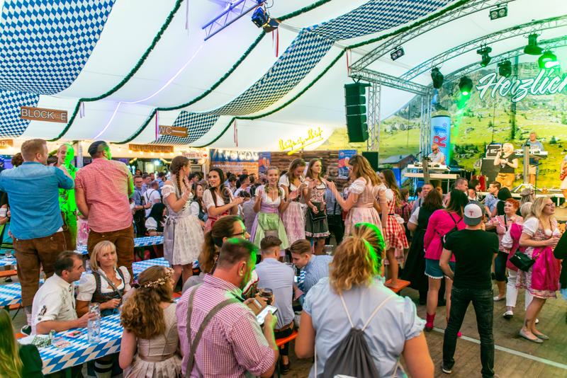 Koblenz Germany -26.09.2018 people party at Oktoberfest in europe during a concert Typical beer tent scene.  stock image