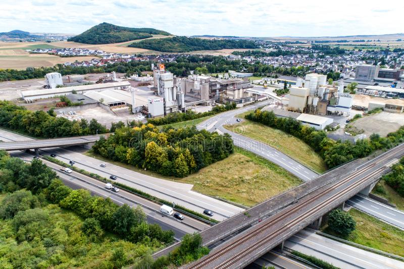 Koblenz GERMANY 21.07.2018 - Quickmix Concrete Batching Plant and construction material factory aerial view.  royalty free stock image
