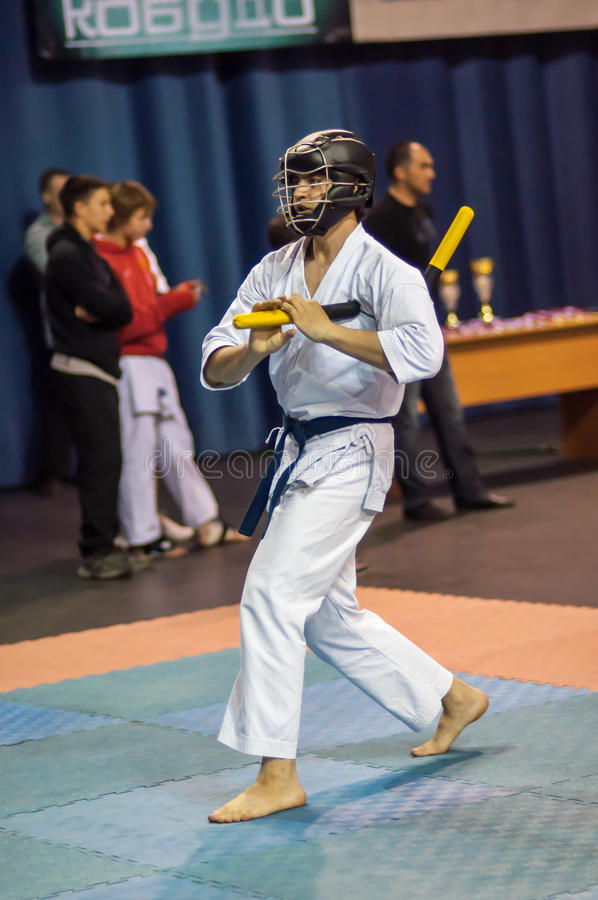 Kobudo competition men with nunchaku stock photos