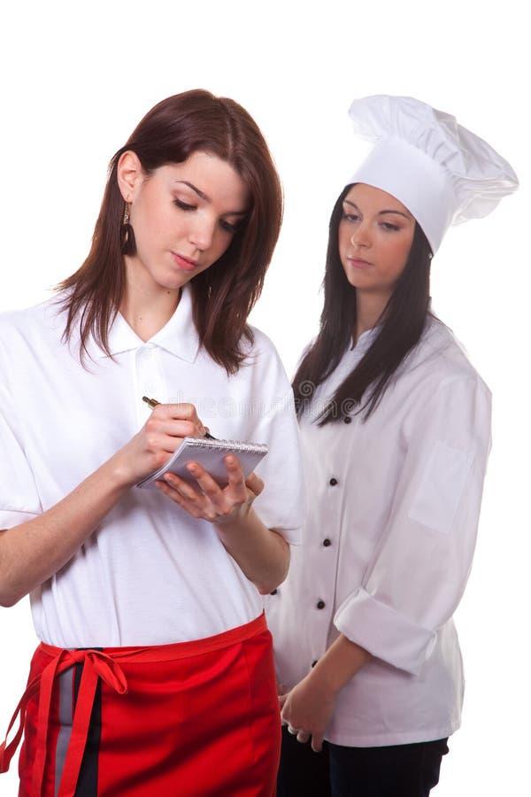 Koch und Service-Kraft wird aufrechterhalten lizenzfreie stockfotos