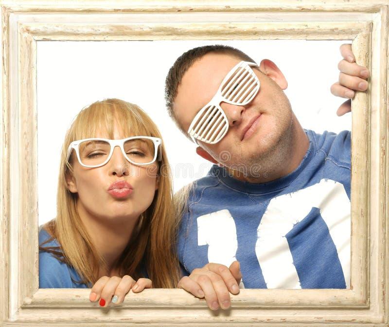 Kochająca para w obrazek ramie fotografia stock