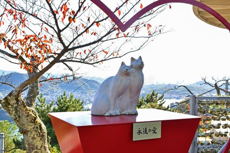 Kochające kot pary figurki przy Senkoji parkiem, Onomichi fotografia stock