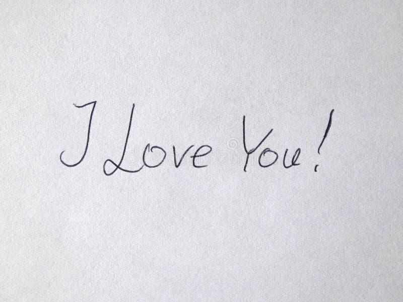 Kocham Ciebie Ręcznie pisany Na papierze fotografia stock