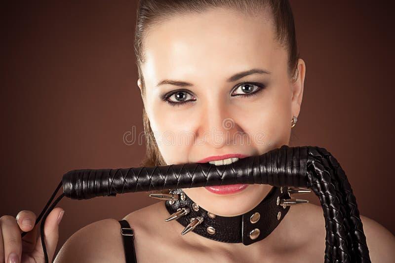 Kochanka z batem w usta obrazy royalty free